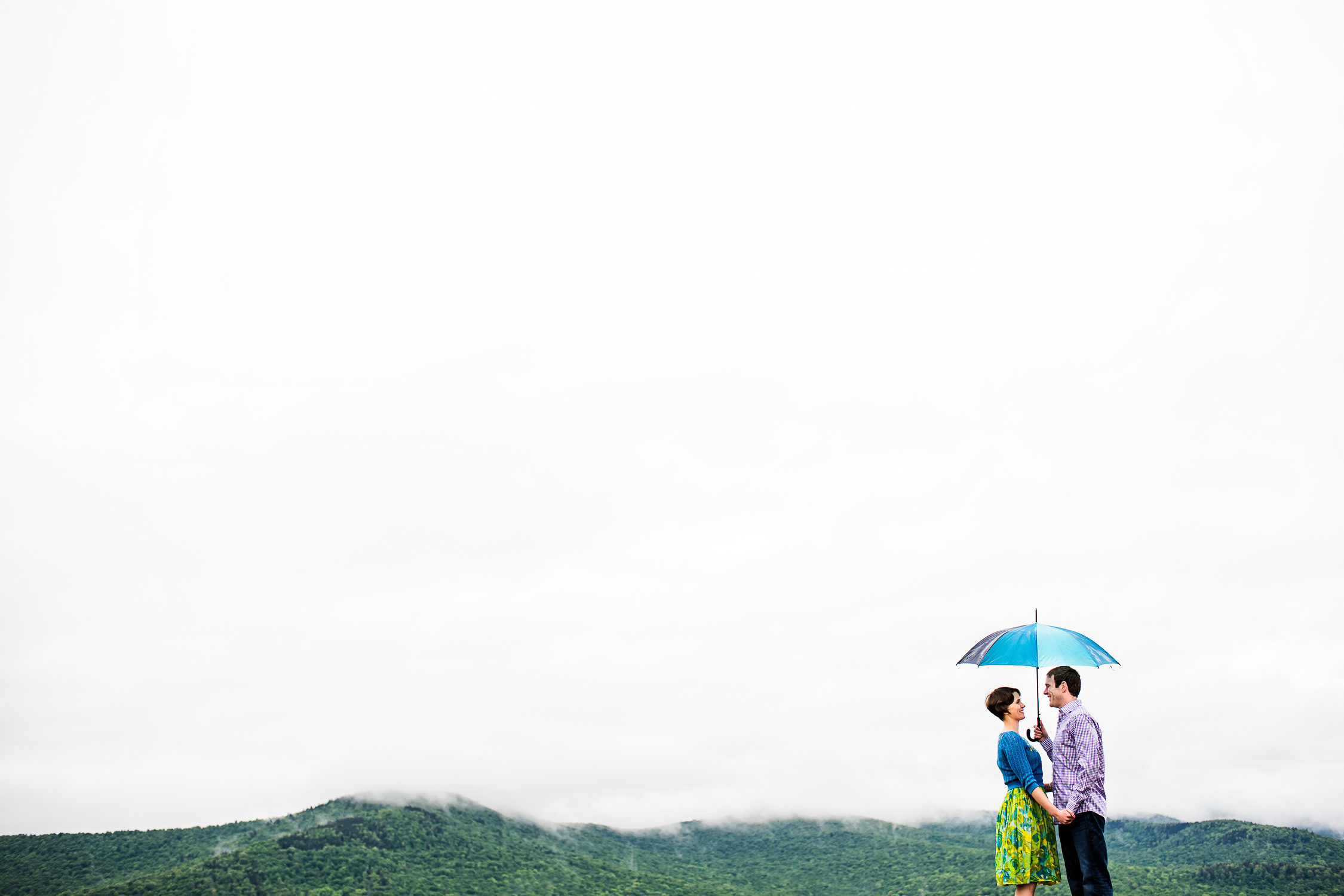 Rain;Stowe;Trapp Family Lodge;Umbrella;Vermont Engagement Photos